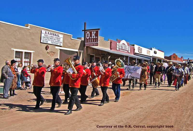 "playing the ""Death March""  while leading Clanton funeral procession beside the OK Corral in Tombstone for 125th anniversary of the historic gunfight"